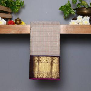 Pastel Grey Coloured Kanchipuram Silk  Saree With Contrast  Dark Purple Pallu