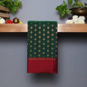 Bottle Green Coloured Kanchipuram Silk  Saree With Contrast Arakku Pallu