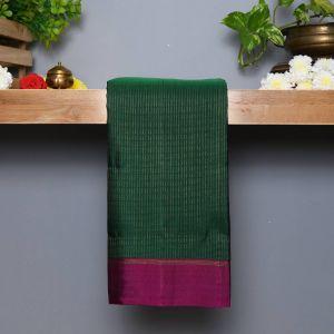 Bottle Green Coloured Kanchipuram Silk Saree with Wine colour Pallu.